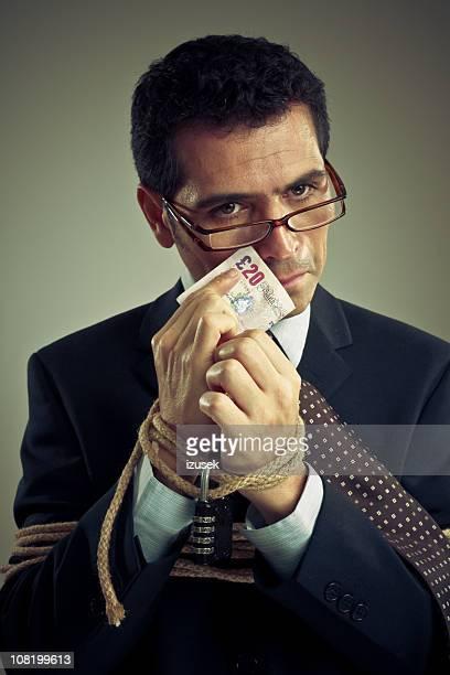 legato uomo d'affari con i soldi - izusek foto e immagini stock