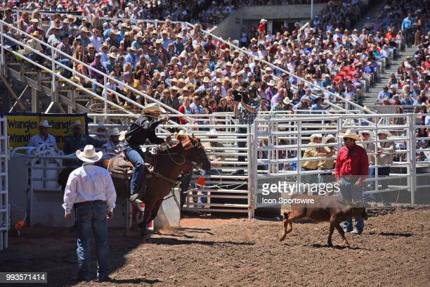 A tiedown roper gets set to chase this calf at the Calgary Stampede on July 7 2018 at Stampede Park in Calgary AB
