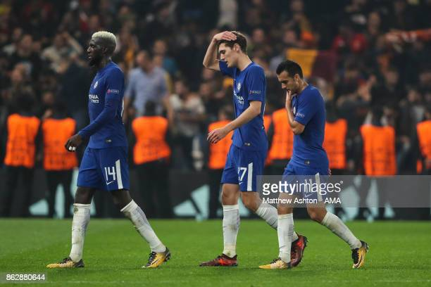 Tiemoué Bakayoko of Chelsea Andreas Christensen of Chelsea and Pedro of Chelsea walk off the pitch dejected at full time during the UEFA Champions...