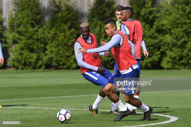 Tiemoue Bakayoko and Kenedy of Chelsea during a training session at Chelsea Training Ground on August 25 2017 in Cobham England