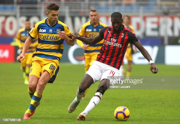 Tiemoue Bakayoko of AC Milan competes for the ball with Alberto Grassi of Parma Calcio during the Serie A match between AC Milan and Parma Calcio at...