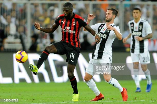 Tiemoue Bakayoko of AC Milan competes for the ball with Miralem Pjanic of Juventus during the Italian Supercup match between Juventus and AC Milan at...