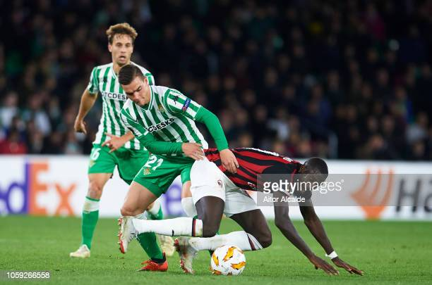 Tiemoue Bakayoko of AC Milan duels for the ball with Giovani Lo Celso of Real Betis during the UEFA Europa League Group F match between Real Betis...