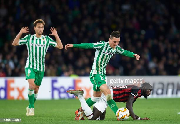 Tiemoue Bakayoko of AC Milan fighst for the ball with Giovani Lo Celso of Real Betis during the UEFA Europa League Group F match between Real Betis...