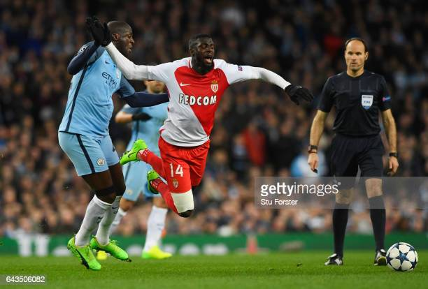 Tiemoue Bakayoko of AS Monaco is tripped by Yaya Toure of Manchester City during the UEFA Champions League Round of 16 first leg match between...
