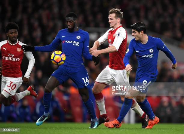 Tiemoue Bakayoko of Chelsea and Alvaro Morata of Chelsea battle for possession with Rob Holding of Arsenal during the Premier League match between...