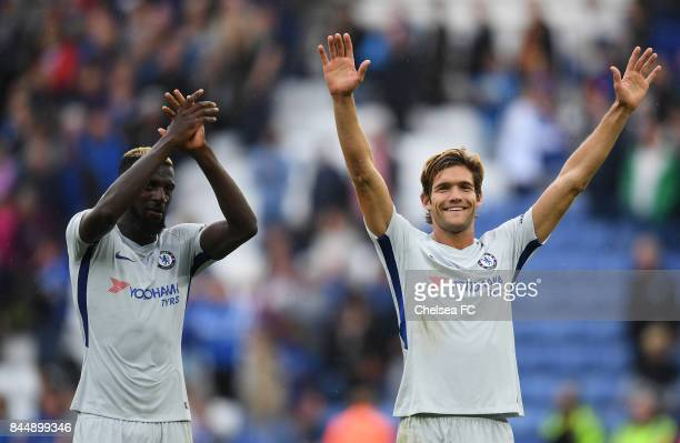 Tiemoue Bakayoko of Chelsea and Marcos Alonso of Chelsea celebrate victory after the Premier League match between Leicester City and Chelsea at The...