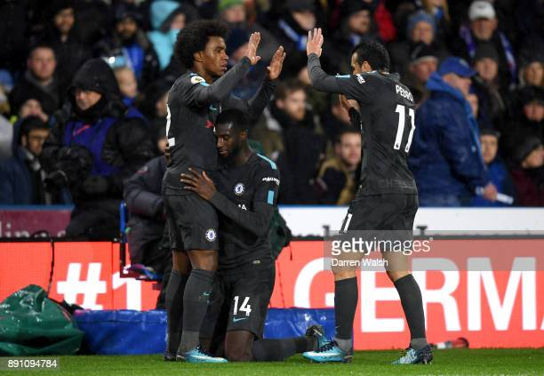 Tiemoue Bakayoko of Chelsea celebrates with his teammates after scoring his sides first goal during the Premier League match between Huddersfield...