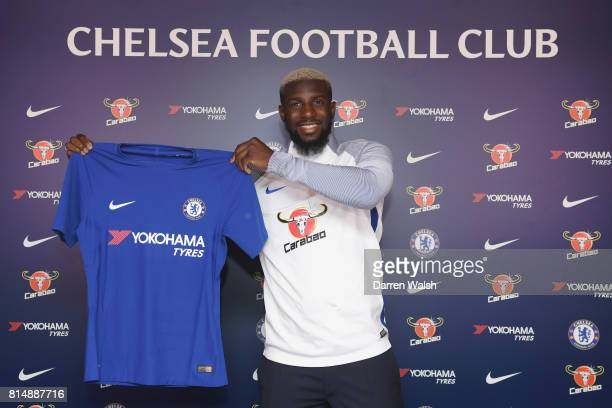 Tiemoue Bakayoko of Chelsea holds his shirt up after signing his 5 year contract for Chelsea at Chelsea Training Ground on July 15 2017 in Cobham...
