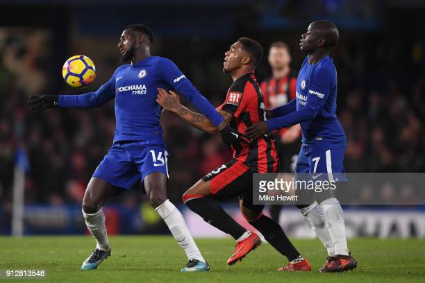 Tiemoue Bakayoko of Chelsea holds off Jordon Ibe of Bournemouth as Ngolo Kante of Chelsea looks on during the Premier League match between Chelsea...