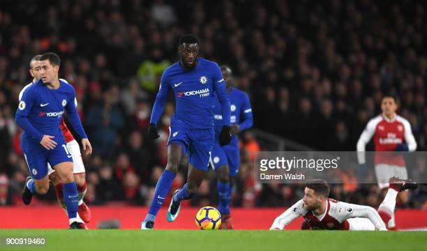 Tiemoue Bakayoko of Chelsea in action as Shkodran Mustafi of Shkodran Mustafi of Arsenal looks on during the Premier League match between Arsenal and...