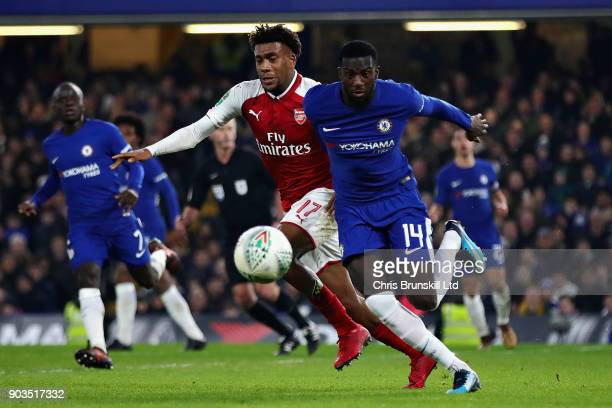 Tiemoue Bakayoko of Chelsea is challenged by Alex Iwobi of Arsenal during the Carabao Cup SemiFinal First Leg match between Chelsea and Arsenal at...
