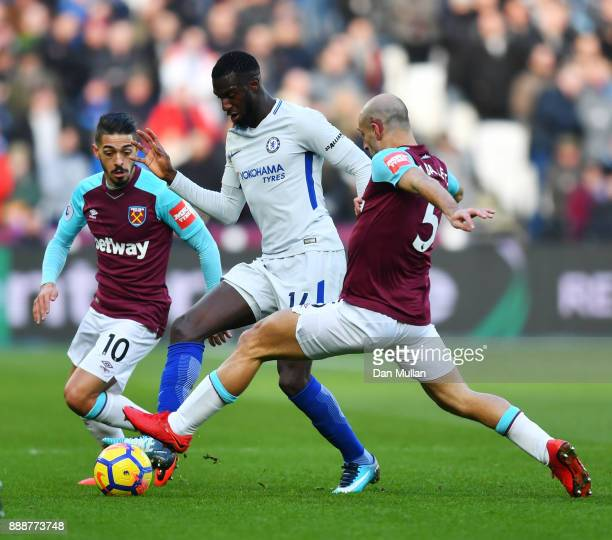 Tiemoue Bakayoko of Chelsea is challenged by Pablo Zabaleta of West Ham United during the Premier League match between West Ham United and Chelsea at...