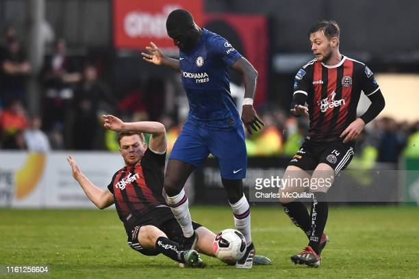 Tiemoue Bakayoko of Chelsea is challenged by Scott Allardice of Bohrmians and Conor Levingston of Bohemians during the PreSeason Friendly match...