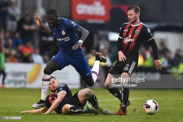 Tiemoue Bakayoko of Chelsea is challenged by Scott Allardice of Bohrmians and Conor Levingston of Bohemians during the Pre-Season Friendly match...
