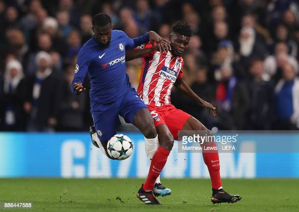Tiemoue Bakayoko of Chelsea is tackled by Thomas Partey of Atletico Madrid during the UEFA Champions League group C match between Chelsea FC and...