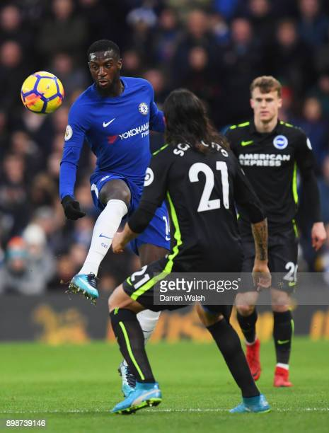 Tiemoue Bakayoko of Chelsea is watched by Matias Ezequiel Schelotto of Brighton and Hove Albion during the Premier League match between Chelsea and...