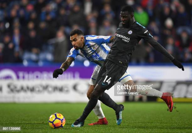 Tiemoue Bakayoko of Chelsea runs with the ball under pressure from Danny Williams of Huddersfield Town during the Premier League match between...