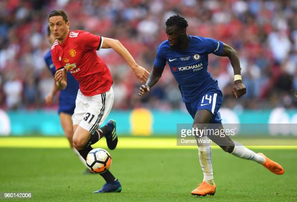 Tiemoue Bakayoko of Chelsea runs with the ball under pressure from Nemanja Matic of Manchester United during The Emirates FA Cup Final between...