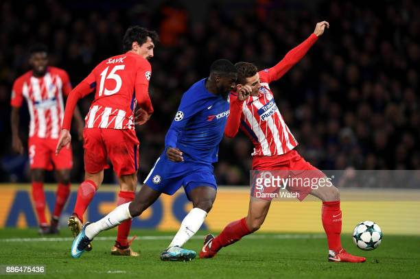 Tiemoue Bakayoko of Chelsea tackles Lucas Hernandez of Atletico Madrid during the UEFA Champions League group C match between Chelsea FC and Atletico...