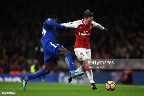 Tiemoue Bakayoko of Chelsea tackles Mesut Ozil of Arsenal during the Premier League match between Arsenal and Chelsea at Emirates Stadium on January...