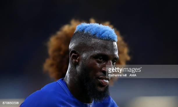 Tiemoue Bakayoko of Chelsea with blue hair stands infront of Marouane Fellaini of Manchester United during the Premier League match between Chelsea...