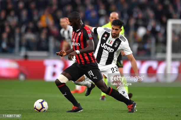 Tiemoue Bakayoko of Milan is challenged by Emre Can during the Serie A match between Juventus and AC Milan on April 06 2019 in Turin Italy