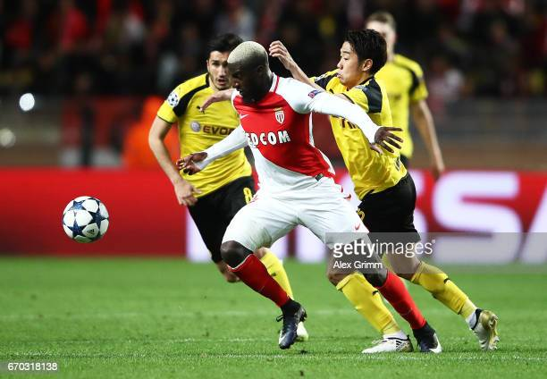 Tiemoue Bakayoko of Monaco is challenged by Shinji Kagawa of Borussia Dortmund during the UEFA Champions League Quarter Final second leg match...