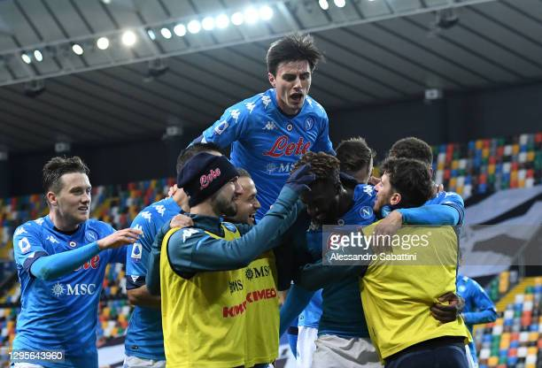 Tiemoue Bakayoko of SSC Napoli celebrates with team mates after scoring their side's second goal as Eljif Elmas jumps on top during the Serie A match...