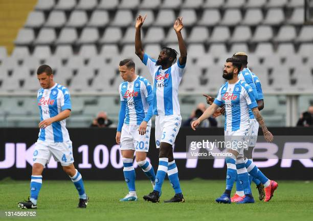 Tiemoue Bakayoko of SSC Napoli celebrates with teammates after scoring their team's first goal during the Serie A match between Torino FC and SSC...