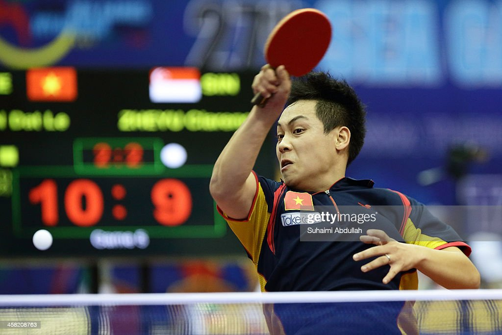 Tien Dat Le of Vietnam hits a return to Chew Zheng Yu Clarence of Singapore during the men's semi-final table tennis match at Wunna Theikdi Indoor Stadium C during the 2013 SEA Games on December 21, 2013 in Nay Pyi Taw, Burma.