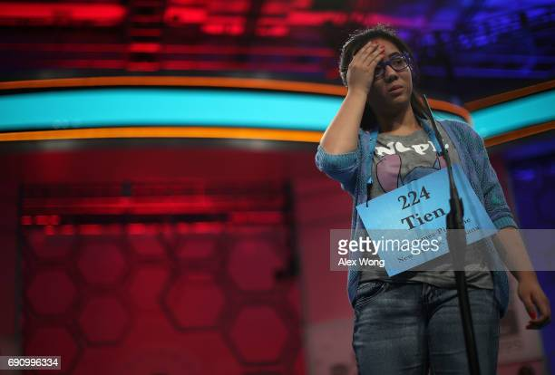 Tien Thuy Nguyen of New Orleans, Louisiana, reacts after she misspelled his word during round three of 2017 Scripps National Spelling Bee at Gaylord...