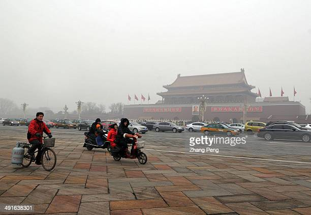 Tienanmen Square in a haze and dust storm In late January Beijing suffered severe haze and dust storms People began wearing antiPM 25 masks outdoors...