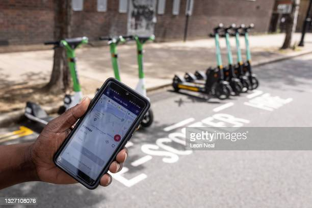 Tier technician shows the GPS phone app that alerts him to the location of faulty units on July 05, 2021 in London, England. Tier Mobility is one of...