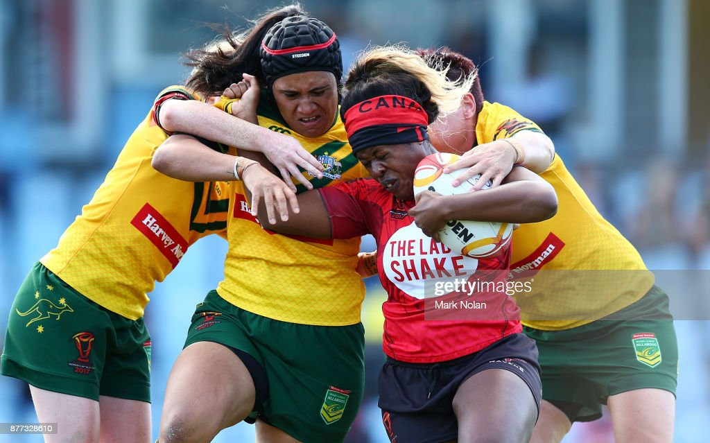 Tiera Reynolds of Canada is tackled during the Women's Rugby League World Cup match between the Canadian Ravens and the Australian Jillaroos at Southern Cross Group Stadium on November 22, 2017 in Sydney, Australia.