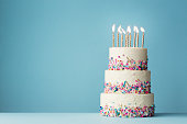 Tiered birthday cake with sprinkles