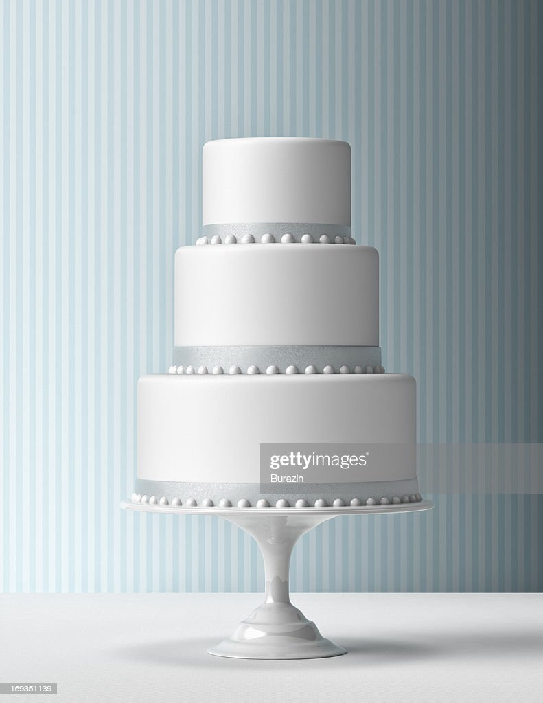 Tiered Fondant Cake with blue background : Stock Photo