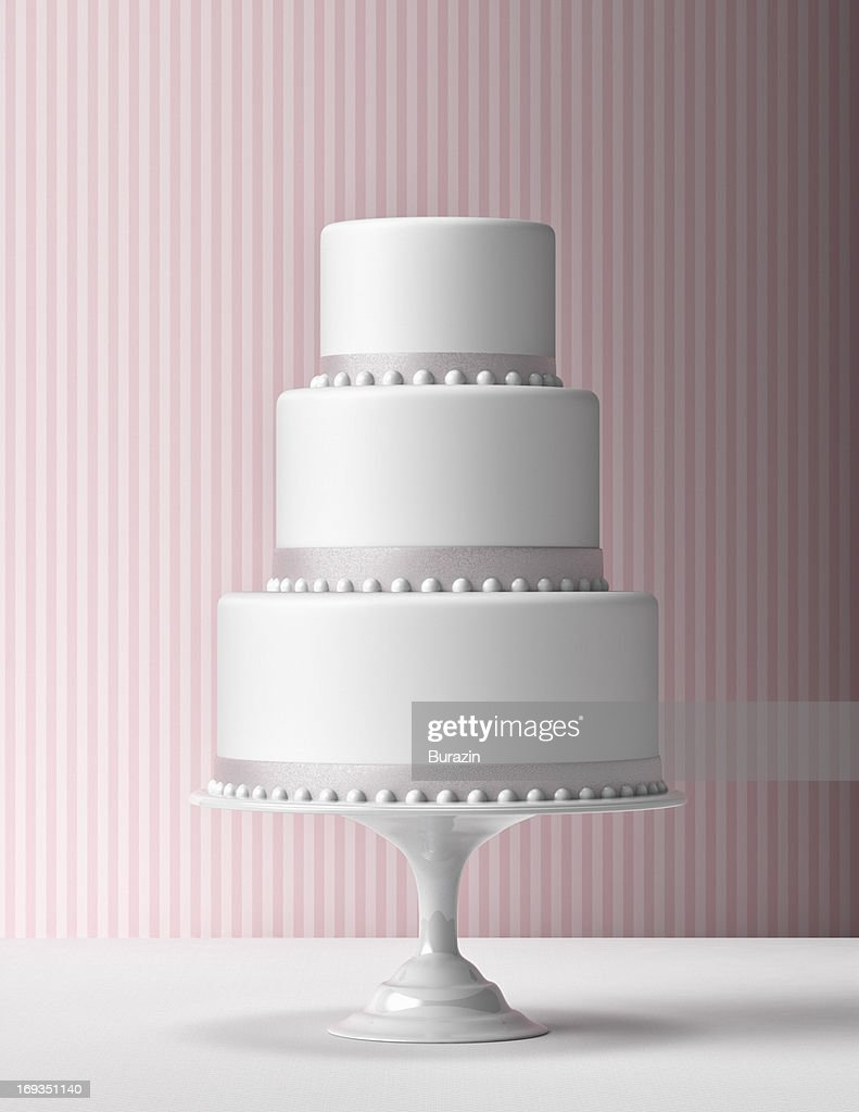 Tiered Fondant Cake with pink background : Stock Photo