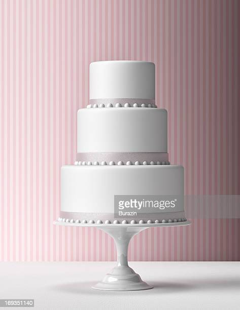 tiered fondant cake with pink background - wedding cake foto e immagini stock
