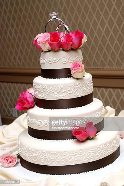 Tiered wedding cake decorated with pink roses