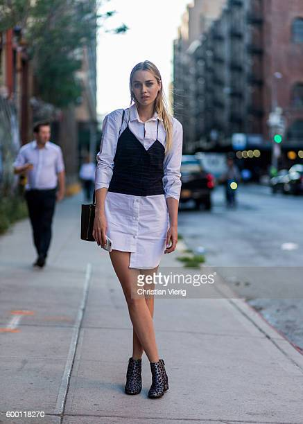 Tiernan Cowling wearing a white button shirt as a dress and Chelsea boots outside R13 on September 7 2016 in New York City