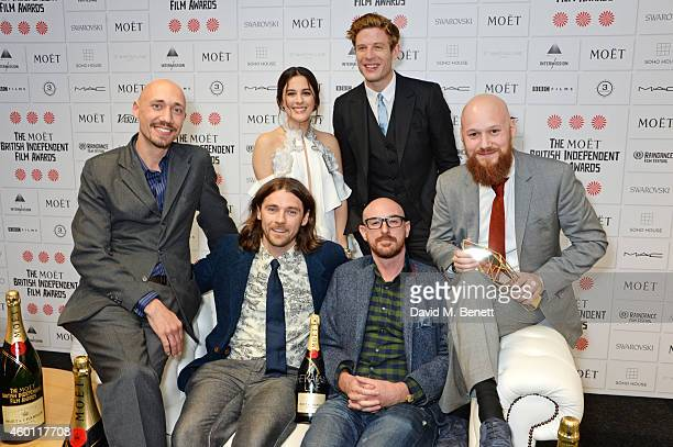 Tiernan Hanby Oscar Sharp and guests winners of the Best Short Film award for 'The Karman Line' pose with presenters Phoebe Fox and James Norton at...
