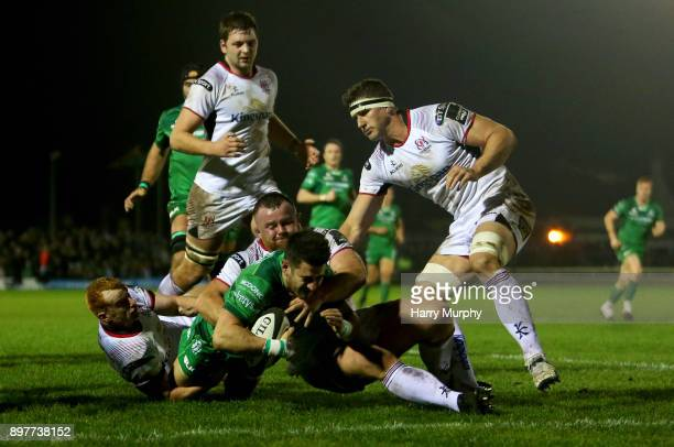 Tiernan O'Halloran of Connacht scores his sides third try during the Guinness PRO14 match between Connacht and Ulster at Sportsground on December 23...