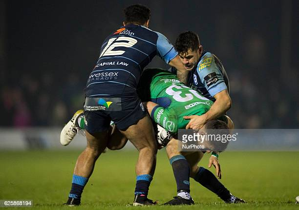 Tiernan O'Halloran of Connacht tackled by Willis Halaholo and Tom James of Cardiff during the Guinness PRO12 Round 9 match between Connacht Rugby and...