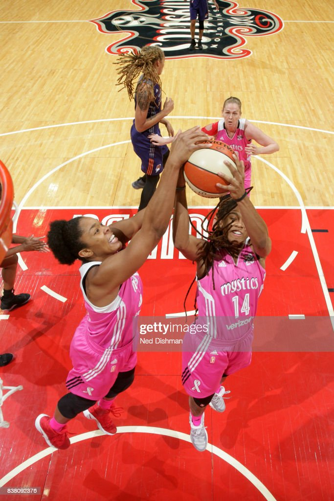 Tierra Ruffin-Pratt #14 and Krystal Thomas #34 of the Washington Mystics go for the rebound against the Phoenix Mercury on August 18, 2017 at the Verizon Center in Washington, DC.