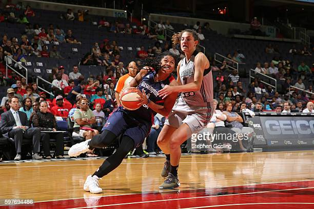 Tierra RuffinPratt of the Washington Mystics drives to the basket against Haley Peters of the San Antonio Stars on August 28 2016 at Verizon Center...