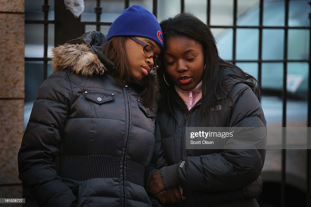 Tierra Woods (L) and Adriana Keith comfort each other after attending the wake of 15-year-old Hadiya Pendleton at the Calahan Funeral Home on February 8, 2013, in Chicago, Illinois. Hadiya was killed when a gunman opened fire on her and some friends as they stood under a shelter on a warm rainy afternoon in a park about a mile from President Obama's Chicago home. First lady Michelle Obama is expected to attend tomorrow's funeral with senior White House adviser Valerie Jarrett and Education Secretary Arne Duncan.