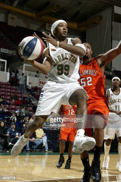 Tierre Brown of Charleston Lowgators passes against the Columbus Riverdragons at the North Charleston Civic Center February 20, 2004 in North...