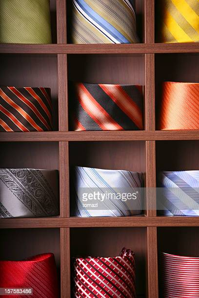 ties store - multi colored suit stock photos and pictures