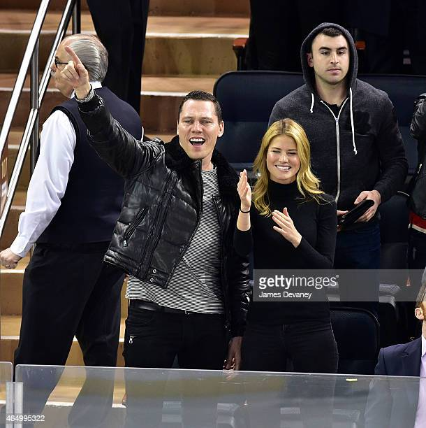 Tiesto and Annmarie Nitti attend the Nashville Predators vs New York Rangers game at Madison Square Garden on March 2 2015 in New York City